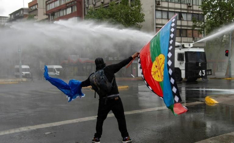 Police used water cannon during the clashes (AFP/Martin BERNETTI)