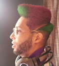 <p>Carbonell says it's important to him to keep pushing styles forward. He updates a Mohawk with color. <i>(Photo: Salón Donde Dorian)</i><b><br></b></p>