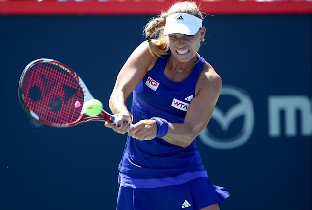 Angelique Kerber returns a shot to Caroline Garcia during the Rogers Cup in Montreal on August 6, 2014 (AFP Photo/Streeter Lecka)