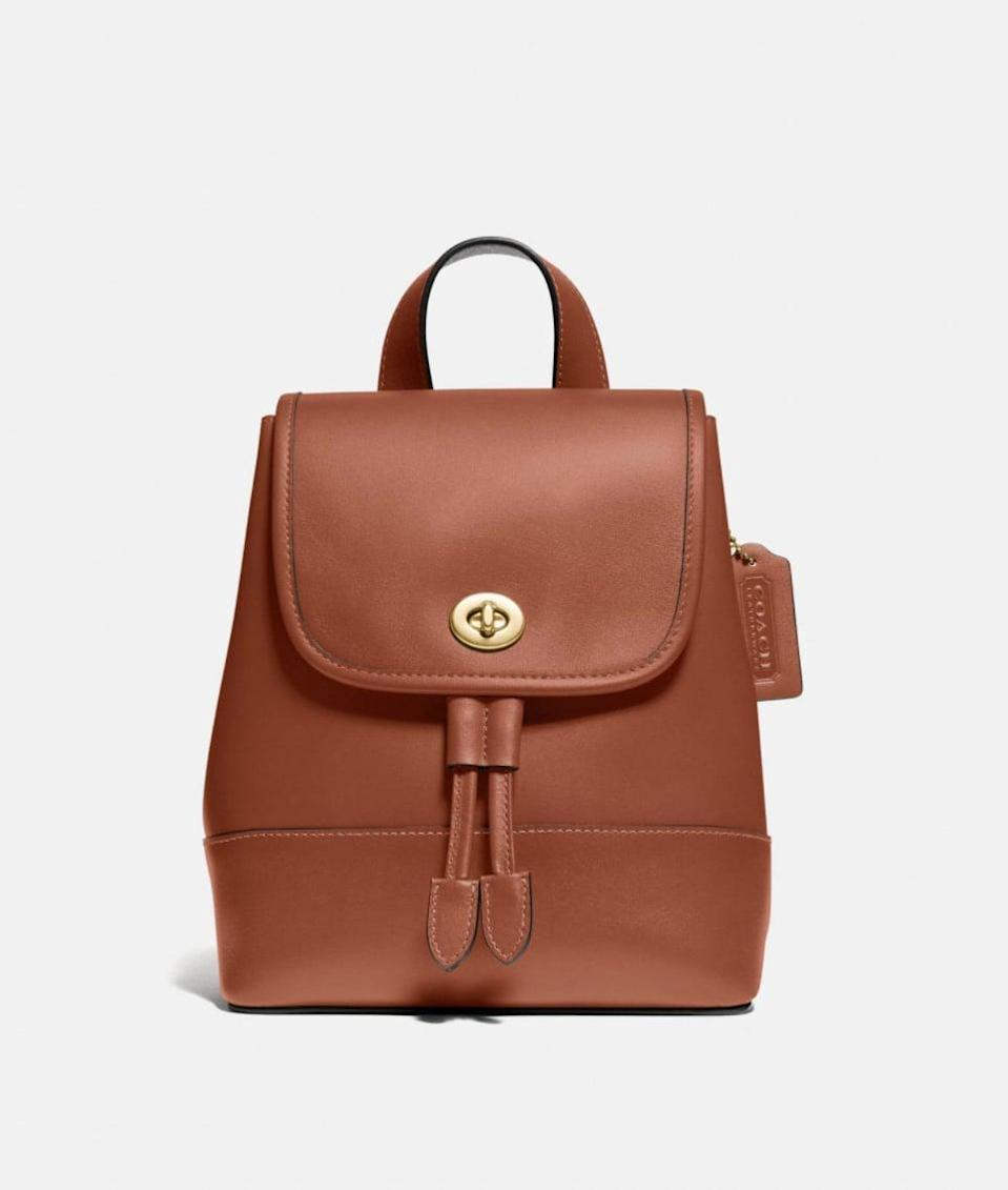 <p>Opt for this easy-to-carry <span>Coach Turnlock Backpack</span> ($350).</p>