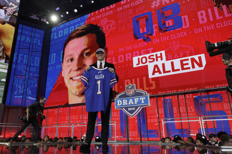 Wyoming's Josh Allen poses with his Buffalo Bills jersey during the first round of the NFL draft on Thursday. (AP)