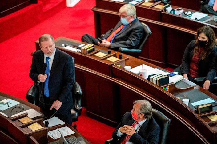 Senate Leader Phil Berger, left, speaks on the Senate floor Monday, March 1, 2021 at North Carolina General Assembly before a failed veto override vote on SB 37, the schools reopening bill Gov. Cooper vetoed. Some North Carolina schools have been remote-only for nearly a year.