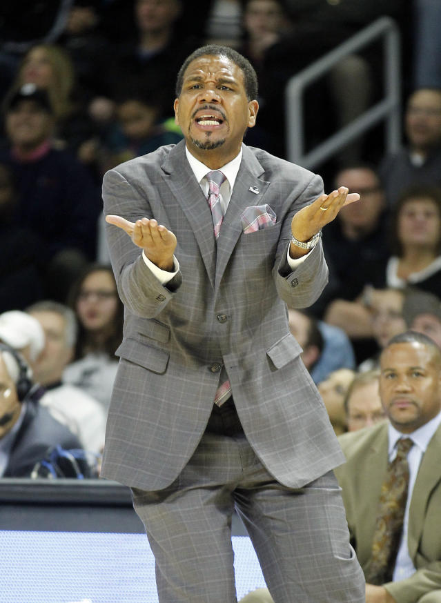 Providence head coach Ed Cooley reacts during the first half of an NCAA college basketball game against Creighton, Saturday, Jan. 18, 2014, in Providence, R.I. (AP Photo/Stew Milne)