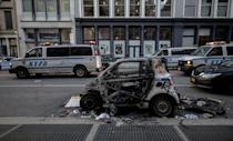 A destroyed New York police car is seen after a night of protests over the death of African-American man George Floyd