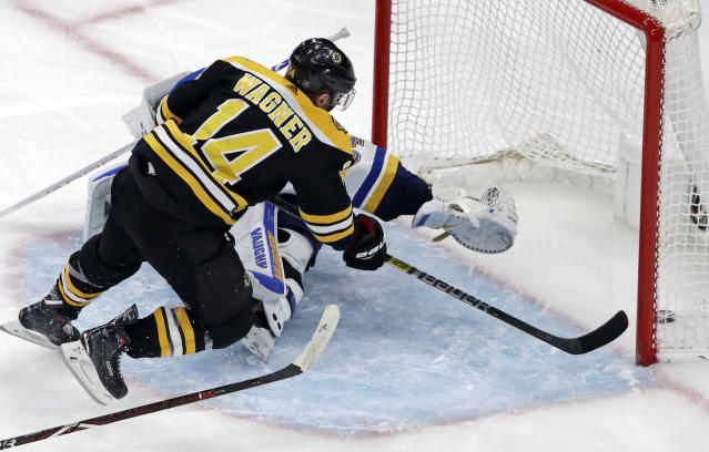 Boston Bruins right wing Chris Wagner (14) scores past the outstretched glove of St. Louis Blues goaltender Jake Allen (34) during the third period of an NHL hockey game, Thursday, Jan. 17, 2019, in Boston. (AP Photo/Elise Amendola)