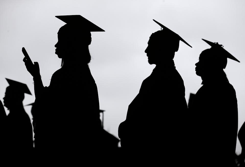 New graduates line up before the start of the Bergen Community College commencement at MetLife Stadium in East Rutherford, N.J., Thursday, May 17, 2018. (AP Photo/Seth Wenig)