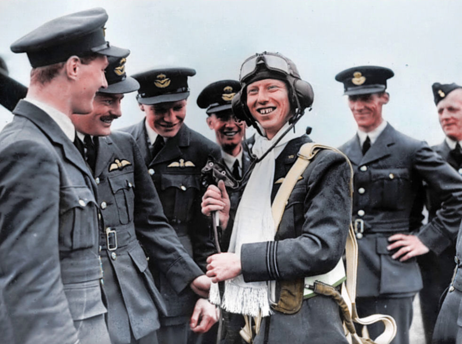 <p>Second World War fighter pilot Flight Lieutenant James 'Ginger' Lacey, downed at least 28 enemy planes. Here he is awarded a silk scarf. (MediaDrumWorld) </p>