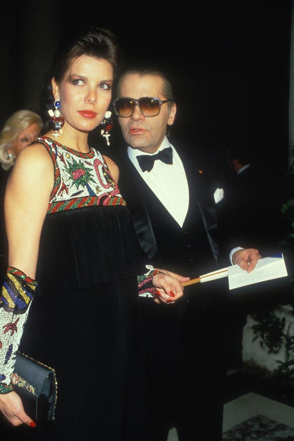 <p>Princess Caroline was famously a longtime friend and champion of Chanel designer Karl Lagerfeld. Here they were photographed together at a party at Versailles in 1986.</p>