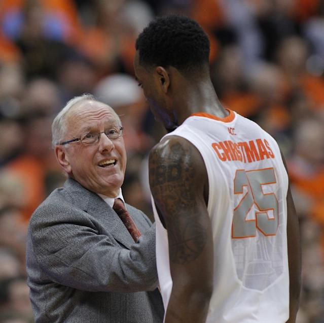 Syracuse's head coach Jim Boeheim, left, talks with Rakeem Christmas late in the second half of an NCAA college basketball game against Pittsburgh in Syracuse, N.Y., Saturday, Jan. 18, 2014. Syracuse won 59-54. (AP Photo/Nick Lisi)