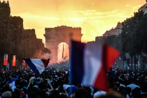 People in Paris celebrate France's World Cup win