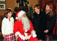 The Duchess of York with her daughters, Princess Beatrice and Princess Eugenie (left), chatting with Santa Claus at the National Society for the Prevention of Cruelty to Children party. (John Stillwell - PA Images)