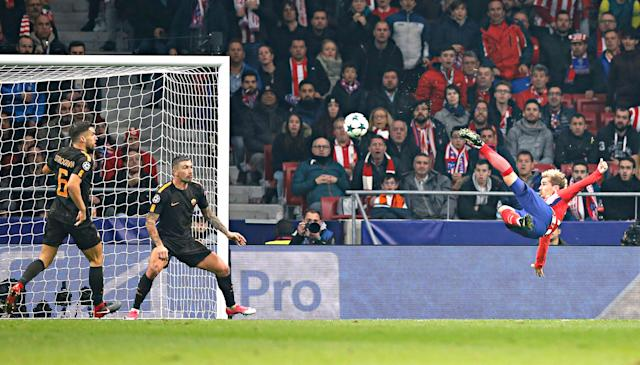 <p>Atletico's Antoine Griezmann shoots to score his side's opening goal during a Champions League group C soccer match between Atletico Madrid and Roma at the Wanda Metropolitano stadium in Madrid, Wednesday, Nov. 22, 2017. (AP Photo/Paul White) </p>
