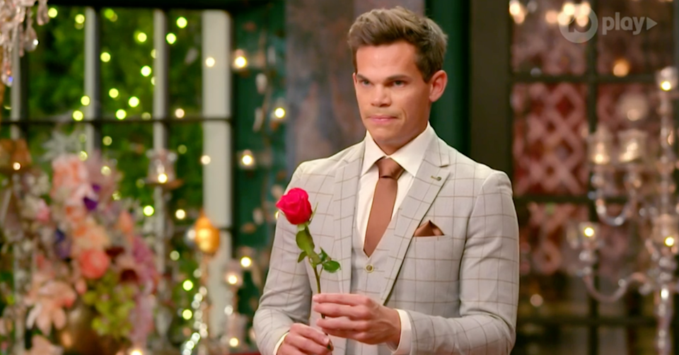 Bachelor Jimmy with a rose.