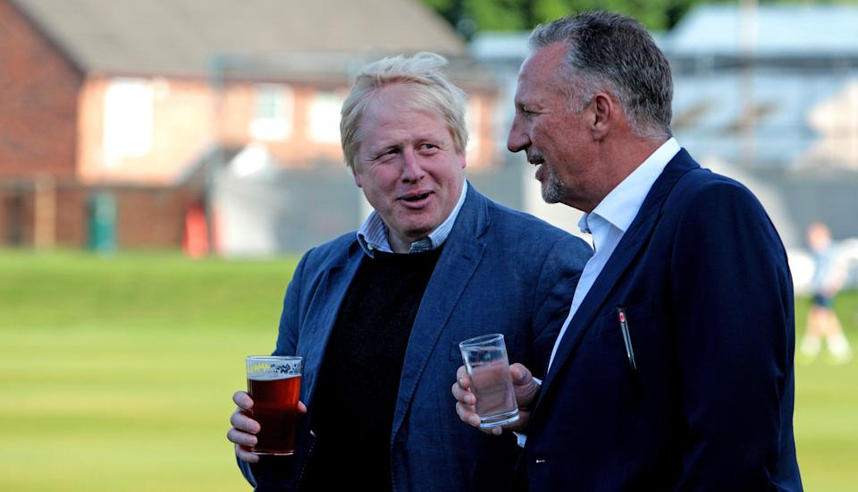 File photo dated 03/05/2016 of former Mayor of London, Boris Johnson (left) talking to Sir Ian Botham, prior to a knock-about during a visit to Chester Le Street Cricket Club in County Durham, as part of his tour on the Vote Leave campaign bus. The former England cricketer is among 30 new peers to be announced later this month, according to The Times.