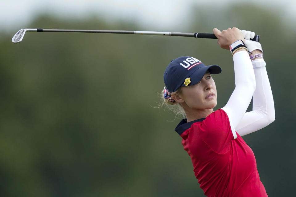 United States' Nelly Korda watches her tee shot during the foursome matches at the Solheim Cup golf tournament, Sunday, Sept. 5, 2021, in Toledo, Ohio. (AP Photo/Carlos Osorio).