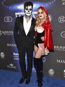 Maksim Chmerkovskiy (left) and wife Peta Murgatroyd at the Maxim Halloween Party
