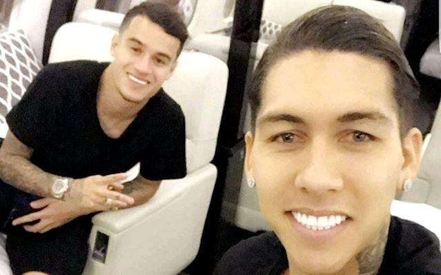 <span>Roberto Firmino with Philippe Coutinho on Liverpool's private jet</span>