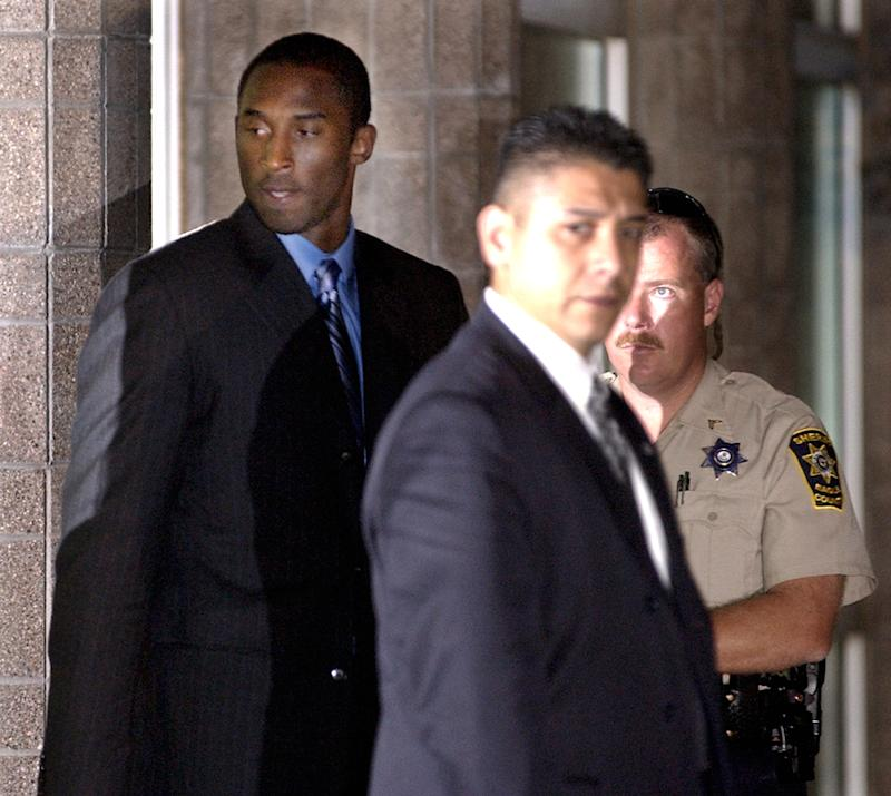 Los Angeles Lakers' star Kobe Bryant, left, leaves the Justice Center Monday, Aug. 30, 2004 in Eagle, Colo., after spending more than 12 hours in court for a pretrial hearing and jury selection. Bryant is appearing in Eagle County District Court facing charges of sexual assault. (AP Photo/M. Spencer Green)