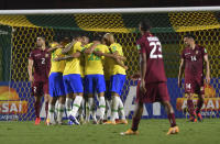 Brazil's Roberto Firmino celebrates with teammates after scoring his side's opening goal against Venezuela during a qualifying soccer match for the FIFA World Cup Qatar 2022 in Sao Paulo, Brazil, Friday, Nov.13, 2020. (Nelson Almeida/Pool via AP)