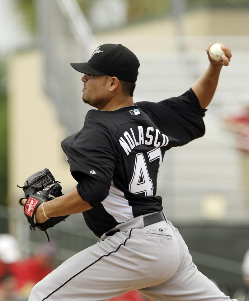 Florida Marlins starting pitcher Ricky Nolasco (47) throws during the fourth inning of a spring training baseball game against the St. Louis Cardinals, Monday, March 28, 2011 in Jupiter, Fla. (AP Photo/Carlos Osorio)