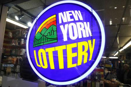 A sign displays the availability of lottery tickets at a store in midtown Manhattan in New York, U.S., October 19, 2018.   REUTERS/Mike Sugar