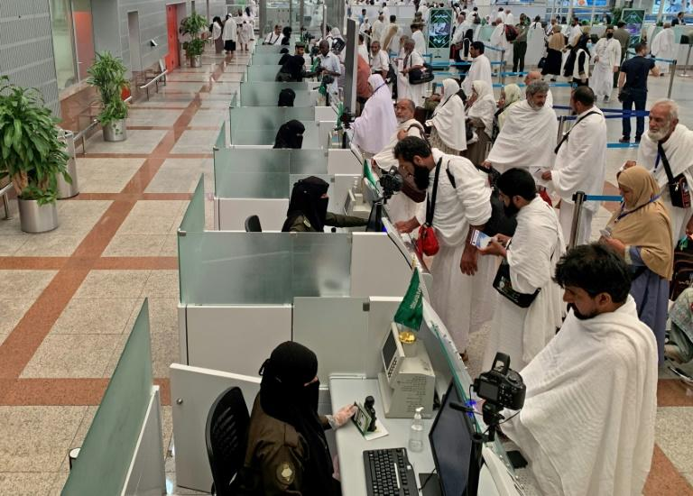 Pilgrims, shown in the Saudi media ministry photo, go through passport control before travelling to Mecca, Islam's holiest city (AFP Photo/-)