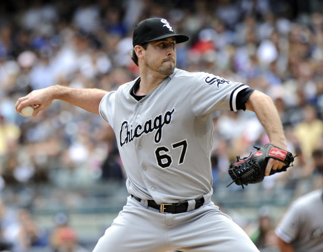 Chicago White Sox pitcher Scott Carroll delivers to the New York Yankees during the first inning of a baseball game Saturday, Aug. 23, 2014, at Yankee Stadium in New York. (AP Photo/Bill Kostroun)