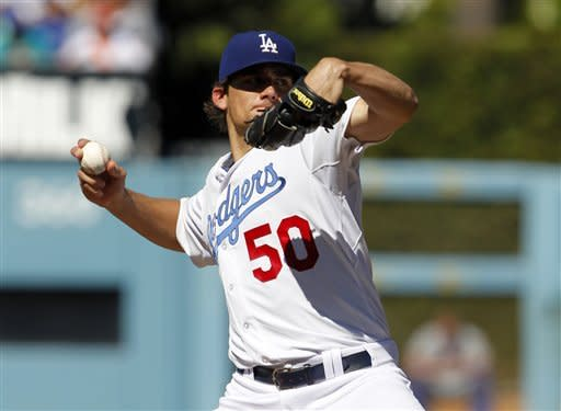 Los Angeles Dodgers starting pitcher Nate Eovaldi (50) pitches against the New York Mets during the first inning of their baseball game in Los Angeles, Saturday, June 30, 2012. (AP Photo/Alex Gallardo)