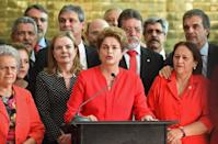 Brazil's former Dilma Rousseff speaks at the Alvorada presidential palace in Brasilia after she was stripped of the country's presidency in a Senate impeachment vote on August 31, 2016 (AFP Photo/Evaristo Sa)
