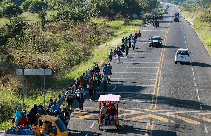 The caravan, pictured along the road between Ciudad Hidalgo and Tapachula, in Chiapas state, southern Mexico, set out from San Pedro Sula, in northwestern Honduras, and has grown along the way (AFP Photo/BENJAMIN ALFARO)