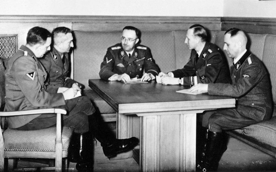 Heinrich Himmler and his colleagues at a meeting. From left: Franz Josef Huber (secret state police), Arthur Nebe (criminal investigation department), Heinrich Himmler, Reinhard Heydrich (security service) and Heinrich Muller (secret state police, also known as Gestapo-Muller) - ullstein bild via Getty Images