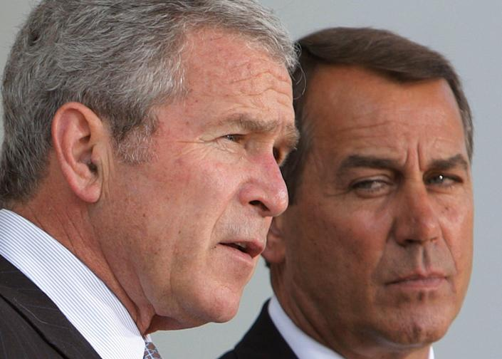 President Bush along with House Minority Leader John Boehner, R-Ohio, right, makes a statement, Wednesday, May 7, 2008, after he met with the House Republican Conference in the East Room, of the White House. Bush criticized the Congressional Democrats' approach in dealing with the U.S. housing crisis and soaring energy prices.