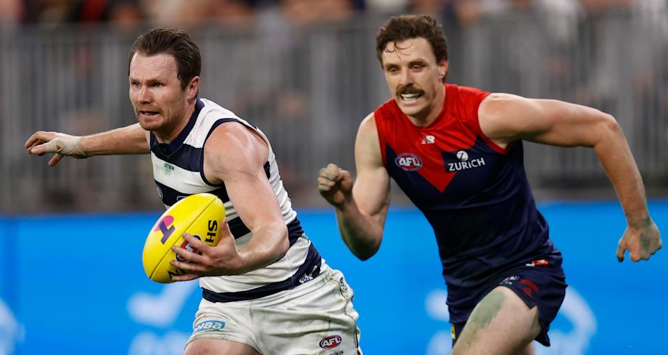 Jake Lever (pictured right) chases Patrick Dangerfield (pictured left) during the 2021 AFL First Preliminary Final match.