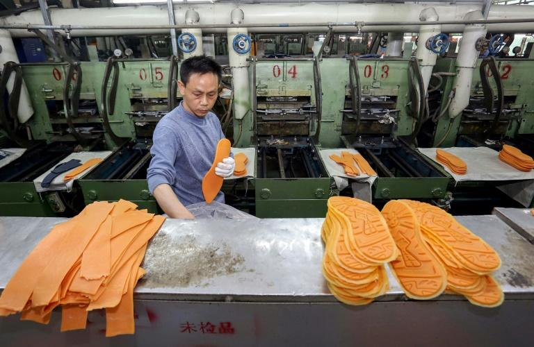 China factory gate inflation slows as commodity prices drop