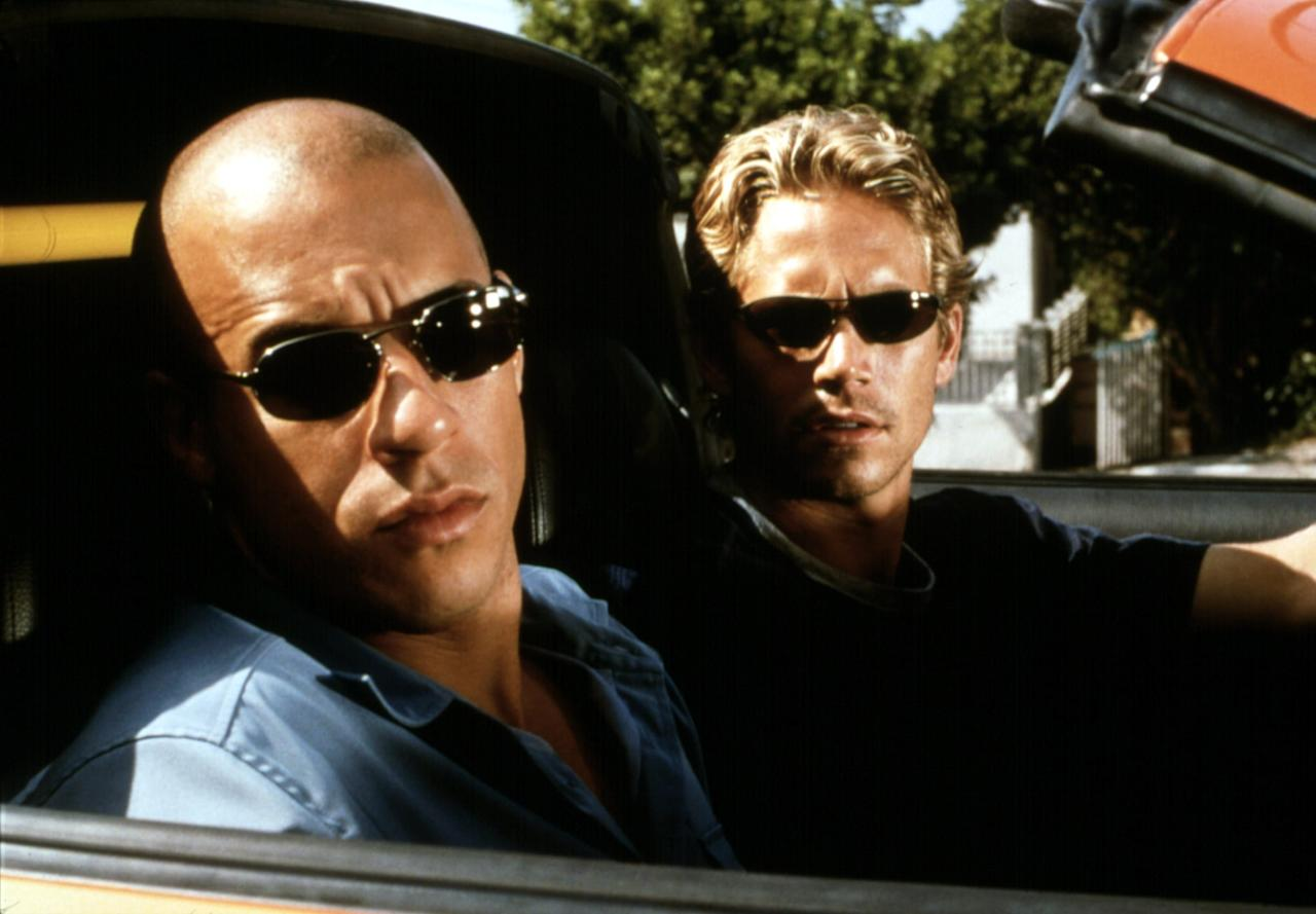 """<p>I hadn't watched <strong>The Fast and the Furious</strong> in probably 10 years (at least), so it was not only super nostalgic but also just a really fun watch. I'd completely forgotten that Brian (<a class=""""sugar-inline-link ga-track"""" title=""""Latest photos and news for Paul Walker"""" href=""""https://www.popsugar.com/Paul-Walker"""" target=""""_blank"""" data-ga-category=""""Related"""" data-ga-label=""""https://www.popsugar.com/Paul-Walker"""" data-ga-action=""""&lt;-related-&gt; Links"""">Paul Walker</a>) is an FBI agent, even though it's a key plot point throughout the entire franchise. I cackled over the fact that the entire reason Brian is undercover is to catch a gang of thieves - led by Vin Diesel's character, Dom - who are stealing Panasonic TVs with in-built VCR players. The movie was released in 2001, and with the combination of high-octane driving scenes, loads of large-scale destruction of Los Angeles streets, and bursts of humor throughout, I couldn't help but think that these were the original Marvel movies.</p>"""