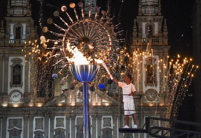 <p>14 year-old Brazilian athlete Jorge Alberto Gomes lit the cauldron at Candelaria Church with the Olympic torch.</p>