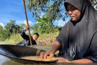 Thai women panning for gold in COVID-hit economy