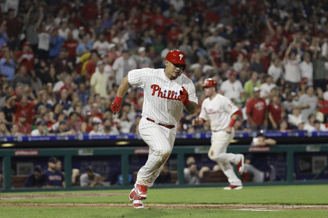 Philadelphia Phillies' Wilson Ramos, left, runs after hitting a two-run double off Boston Red Sox relief pitcher Drew Pomeranz during the seventh inning of a baseball game Wednesday, Aug. 15, 2018, in Philadelphia. Philadelphia won 7-4. (AP Photo/Matt Slocum)