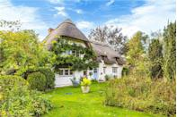 "<p>As pretty as a picture book, this charming thatched cottage has four <a href=""https://www.housebeautiful.com/uk/decorate/bedroom/a35201382/bedroom-lighting-ideas/"" rel=""nofollow noopener"" target=""_blank"" data-ylk=""slk:bedrooms"" class=""link rapid-noclick-resp"">bedrooms</a>, four bathrooms, idyllic gardens, wooden beams stretched across the ceiling, and traditional features, too. Tempted? you'll need £1.2 million to make it your own. </p><p><a href=""https://www.zoopla.co.uk/for-sale/details/56505757"" rel=""nofollow noopener"" target=""_blank"" data-ylk=""slk:This property is currently on the market for £1,275,000 with Scott Fraser via Zoopla."" class=""link rapid-noclick-resp"">This property is currently on the market for £1,275,000 with Scott Fraser via Zoopla.</a><br></p>"