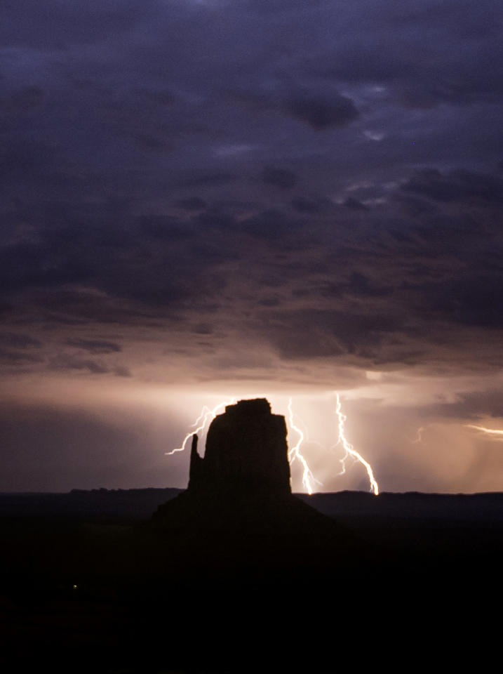<p>Rain and lightning bolts hammer the desolate terrain of Monument Valley, Ariz. (Photo: Jennifer Khordi/Caters News) </p>