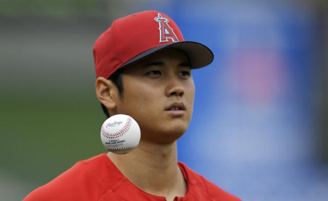 Los Angeles Angels' Shohei Ohtani, of Japan, tosses a ball in the air as he warms up prior to a baseball game against the Tampa Bay Rays, Saturday, May 19, 2018, in Anaheim, Calif. (AP Photo/Mark J. Terrill)