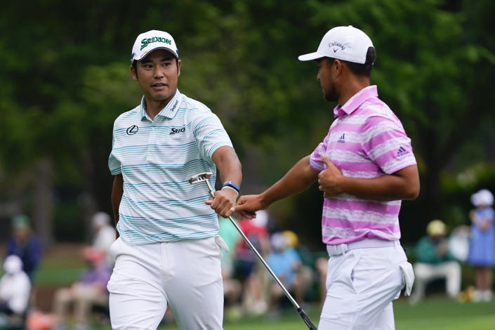 Hideki Matsuyama, of Japan, and Xander Schauffele, right, congratulate themselves after their eagles on the 15th hole during the third round of the Masters golf tournament on Saturday, April 10, 2021, in Augusta, Ga. (AP Photo/Matt Slocum)