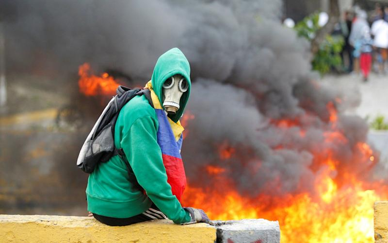 Venezuela is currently gripped by mass demonstrations against the government - REUTERS