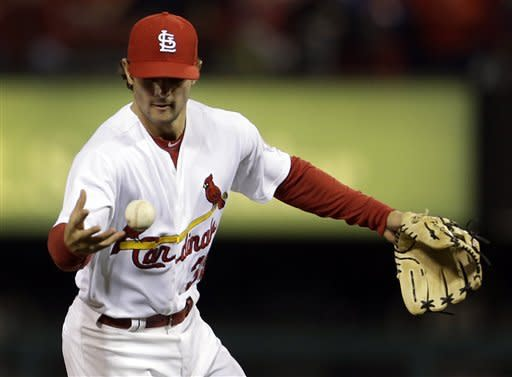 St. Louis Cardinals shortstop Pete Kozma bobbles a ball hit for a single by Cincinnati Reds' Drew Stubbs during the third inning of a baseball game, Monday, Oct. 1, 2012, in St. Louis. (AP Photo/Jeff Roberson)