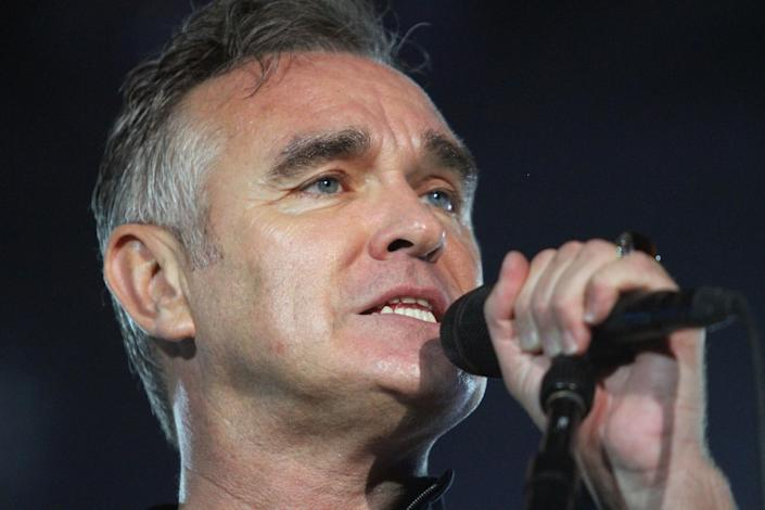 """FILE - In this July 21, 2012 file photo, British rock singer Morrissey, the former front man of the alternative rock group The Smiths, sings during his concert in Tel Aviv, Israel. Animal rights activist and singer Morrissey said he's canceled an appearance Tuesday, Feb. 26, 2013, on Jimmy Kimmel's talk show because cast members of A&E's """"Duck Dynasty"""" also were scheduled to appear. (AP Photo/Dan Balilty, File)"""