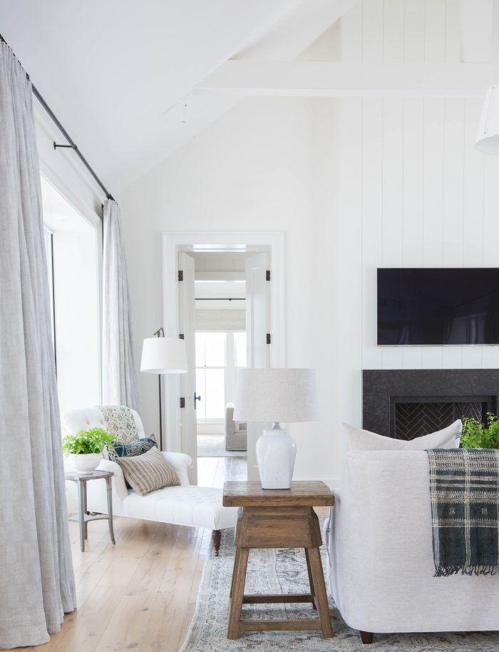 <p>There's nothing quite like white paint to open up a space. This media room is airy and open, yet still cozy. The key is to layer in plenty of plush elements, like throw blankets, a carpet, and curtains. If you host a lot or have a large family, consider adding extra seating with a corner chaise. </p>