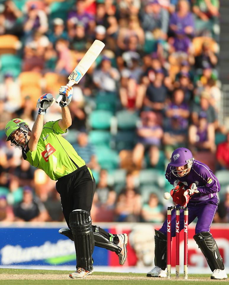 HOBART, AUSTRALIA - DECEMBER 23: Ryan Carters of the Thunder misses the ball and is stumped by Tim Paine of the Hurricanes during the Big Bash League match between the Hobart Hurricanes and the Sydney Thunder at Blundstone Arena on December 23, 2012 in Hobart, Australia.  (Photo by Robert Cianflone/Getty Images)