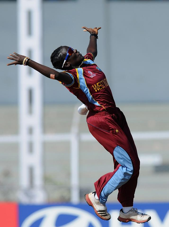 MUMBAI, INDIA - FEBRUARY 17:  Kyshona Knight of West Indies celebrates after taking the catch to get Rachael Haynes of Australia out during the final between Australia and West Indies held at the CCI (Cricket Club of India) stadium on February 17, 2013 in Mumbai, India.  (Photo by Pal Pillai/Getty Images)
