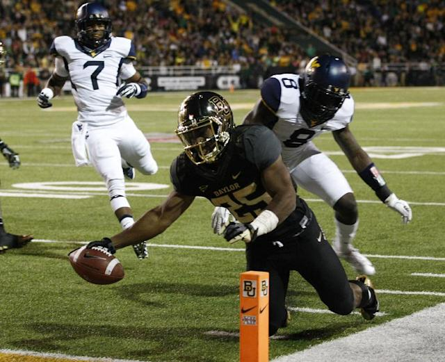 *Baylor running back Lache Seastrunk (25) scores past West Virginia safety Karl Joseph (8), right, during the first half of an NCAA college football game onSaturday, Oct. 5, 2013, in Waco, Texas. (AP Photo/Jose Yau)