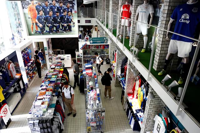 Customers look at goods at soccer shop KAMO in Tokyo, Japan May 17, 2018. REUTERS/Kim Kyung-Hoon